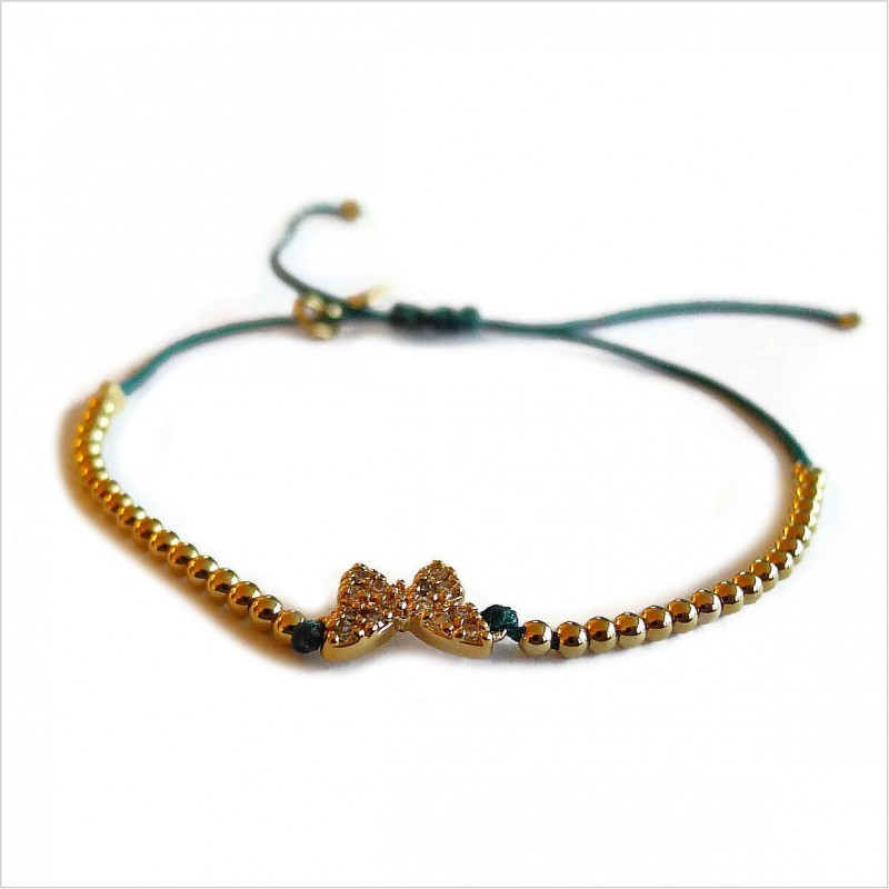 Zirconium butterfly with small bead on sliding link