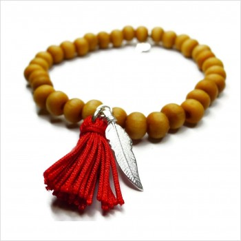 Tibetan bracelet with mini charms and plain pompon