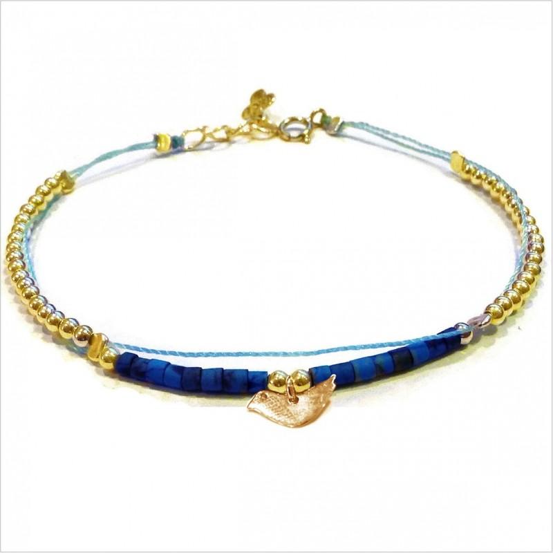Tube stones bracelet with a bird mini charm