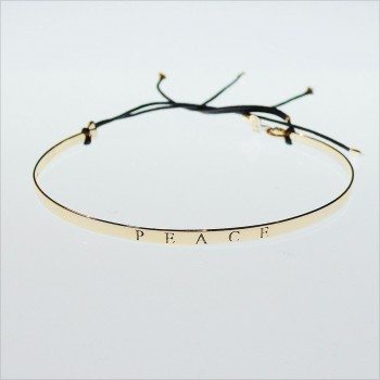 The peace flat knotted bangle