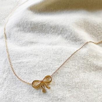 Collier pendentif en forme de noeud sur chaine en plaqué or - bijoux fins et fantaisies